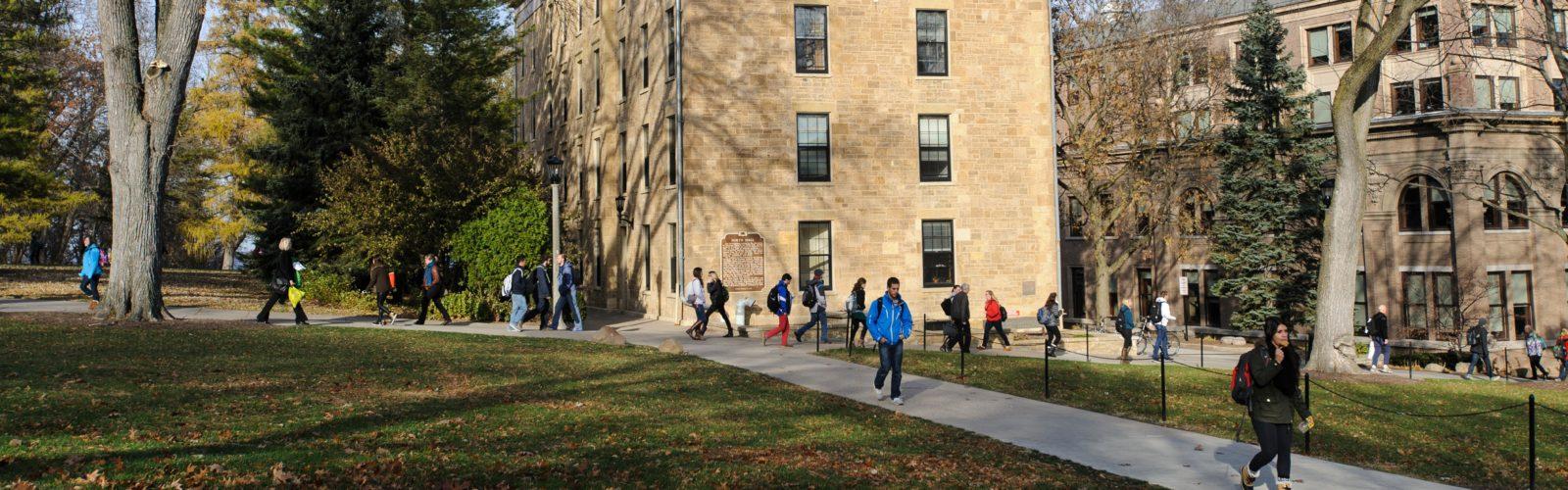 Students walk past North Hall.