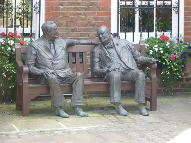 Franklin D Roosevelt & Winston Churchill on a bench talking