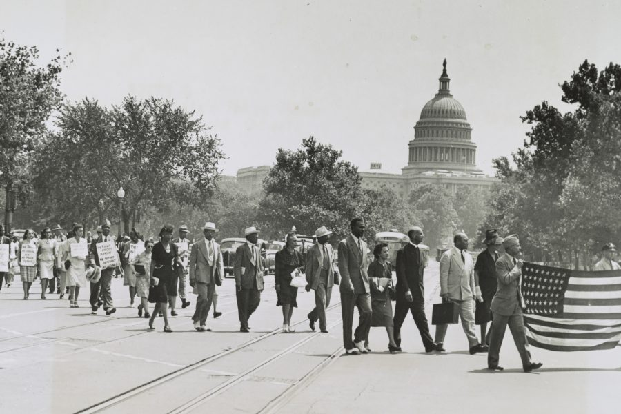 Group of African-Americans, marching near the Capitol building in Washington, D.C., to protest the lynching of four African-Americans in Georgia