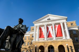 W banners hang from the columns of Bascom Hall at the University of Wisconsin-Madison during winter on Dec. 9, 2016. In the foreground, at left, is the Abraham Lincoln statue. (Photo by Jeff Miller/UW-Madison)